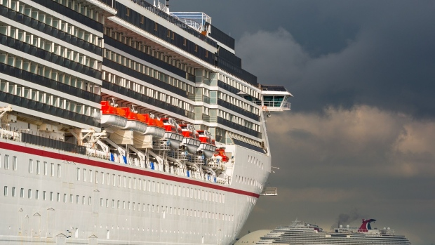 "The Carnival Corp. Miracle and Panorama cruise ships sit acnhored at the Port of Long Beach in Long Beach, California, U.S., on Monday, April 13, 2020. The Centers for Disease Control and Prevention extended its ""No Sail Order"" for all cruise ships by at least 100 days -- or until Covid-19 is no longer considered a public health emergency. Photographer: Tim Rue/Bloomberg"