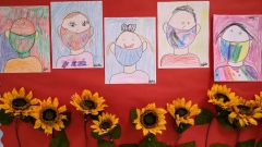 Drawings of children wearing masks adorn a hallway at Stark Elementary School on September 16, 2020 in Stamford, Connecticut Photographer: John Moore/Getty Images