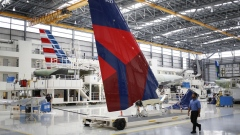 Employees walk past an Airbus SE A321 vertical stabilizer with a livery for Delta Air Lines Inc. on the production floor of the Airbus Final Assembly Line facility in Mobile, Alabama, U.S., on Wednesday, July 19, 2017. The U.S. Census Bureau is scheduled to release durable goods figures on August 3.
