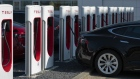 Tesla Inc. electric automobiles sit charging at a Tesla Supercharger station in Zaltbommel, Netherlands.