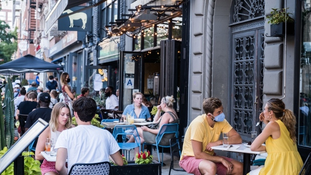 NEW YORK, NY - JULY 21: People dine al fresco, or open air, in the East Village on July 21, 2020 in New York City. New York City's Open Restaurant Program, which seeks to phase in city-side options to expand outdoor seating for food establishments, has been extended through October. (Photo by Jeenah Moon/Getty Images)
