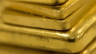 A selection of gold bars of various weights sit at Gold Investments Ltd. bullion dealers in this arranged photograph in London, U.K., on Wednesday, July 29, 2020. Gold held its ground after a record-setting rally as investors awaited the outcome of a Federal Reserve meeting amid expectations policy makers will remain dovish, potentially spurring more gains. Photographer: Chris Ratcliffe/Bloomberg