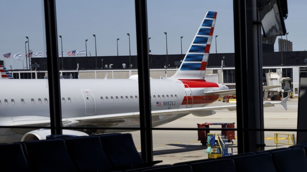 American Airlines planes at O'Hare International Airport (ORD) in Chicago. Photographer: Patrick T. Fallon/Bloomberg