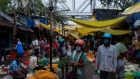 Shoppers wearing protective masks walks past vendors at Mullick Ghat flower market in Kolkata, India, on Tuesday, Sept. 22, 2020. India's economic recovery prospects have gone from bad to worse after the nation emerged as a new global hotspot for the coronavirus pandemic with more than 5 million infections.