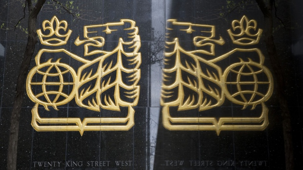 The Royal Bank of Canada (RBC) logo is reflected on a surface in Toronto, Ontario, Canada, on Friday, May 19, 2017. Ontario is easing rules for its pension funds as years of low interest rates, poor equity returns and a looming retiree glut pressure companies. Photographer: Brent Lewin/Bloomberg