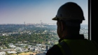 A construction worker looks out towards the Central Business District (CBD) on the city skyline from inside The Leonardo, the Legacy Group's mixed-use property development, currently Africa's tallest building, in the Sandton district of Johannesburg, South Africa, on Tuesday, Sept. 17, 2019. Emerging markets will again be looking to central banks to provide the next leg-up in a rally that's making it the best September so far for stocks and currencies since 2013. Photographer: Waldo Swiegers/Bloomberg