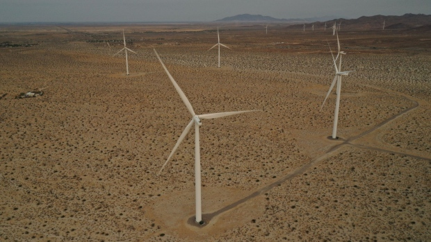 2.37 MW (megawatt) wind turbines, manufactured by Siemens AG, are seen in this aerial photograph taken at the Ocotillo Wind Farm, a 265 MW facility, near Ocotillo, California, U.S. on Friday, Sept. 11, 2020. As the threat of blackouts continues to plague California, officials are pointing to battery storage as a key to preventing future power shortfalls. But the Golden State is going to need a lot more batteries to weather the next climate-driven crisis—let alone to achieve its goal of a carbon-free grid. Photographer: Bing Guan/Bloomberg