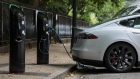 A charging plugs connects a Tesla Inc. Model S electric vehicle (EV) to a charging station in London, U.K., on Friday, Aug. 4, 2017. The U.K. government plans to invest more than 800 million pounds ($1 billion) in new driverless and zero-emission vehicle technology as it seeks to boost its economy while leaving the European Union.