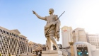 A statue of Julius Caesar wears a mask at the entrance of the Caesars Entertainment Caesars Palace hotel and casino in Las Vegas on July 28.