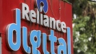 Signage for Reliance Digital Retail Ltd., a subsidiary of Reliance Industries Ltd., is displayed outside a company store in Mumbai, India, on Tuesday, July 14, 2020. Google is in advanced talks to buy a $4 billion stake in Jio Platforms Ltd., the digital arm of Indian billionaire Mukesh Ambani's conglomerate, people familiar with the matter said, seeking to join rival Facebook Inc. in chasing growth in a promising internet and e-commerce market. Photographer: Dhiraj Singh/Bloomberg