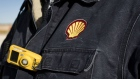 A Royal Dutch Shell Plc representative wears a shirt with the company's logo at an oil rig site near Mentone, Texas, U.S., on Thursday, March 2, 2017. Exxon Mobil Corp., Royal Dutch Shell and Chevron Corp., are jumping into American shale with gusto, planning to spend a combined $10 billion this year, up from next to nothing only a few years ago. Photographer: Matthew Busch/Bloomberg