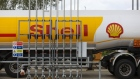 A Shell tanker sits parked at a Royal Dutch Shell Plc petrol filling station in Cobham, U.K., on Wednesday, Sept. 30, 2020. Royal Dutch Shell Plc will cut as many as 9,000 jobs as Covid-19 accelerates a company-wide restructuring into low-carbon energy. Photographer: Chris Ratcliffe/Bloomberg