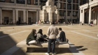 Pedestrian sit in Paternoster Square in the City of London, U.K., on Monday, Sept. 28, 2020. Londoners are looking for jobs outside the capital as the city struggles to generate new work after the coronavirus slump.