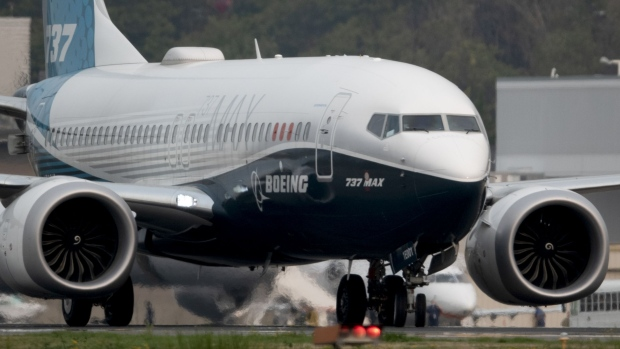 The Boeing Co. 737 Max airplane lands during a test flight in Seattle, Washington, U.S., on Wednesday, Sept. 30, 2020. Federal Aviation Administration chief Steve Dickson, who is licensed to fly the 737 along with several other jetliners from his time as a pilot at Delta Air Lines Inc., will be at the controls of a Max that has been updated with a variety of fixes the agency has proposed and may soon make mandatory. Photographer: Chona Kasinger/Bloomberg