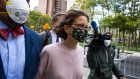 Clare Bronfman, daughter of former Seagram Chairman Edgar M. Bronfman, center, arrives at federal court in the Brooklyn borough of New York, U.S., on Wednesday, Sept. 30, 2020. Bronfman was charged with helping finance the activities of Nxivm, an upstate New York cult accused of branding its victims and forcing them to participate in sex acts. She pleaded guilty to conspiracy charges and could spend more than two years in federal prison.
