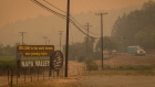 A Napa Valley welcome sign in the smoke filled the air from the Glass Fire in St. Helena, California, on Sept. 28.