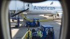 Workers load bags onto an American Airlines flight at Dallas/Fort Worth International Airport (DFW) on Sept. 28, 2020.