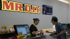 An employee assists a customer at Mr. DIY store in Singapore. Photographer: Wei Leng Tay/Bloomberg