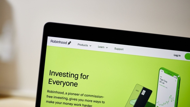 The website home screen for Robinhood is displayed on a laptop computer.