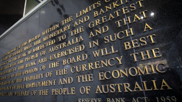 The Reserve Bank Act 1959 is displayed in the foyer of the Reserve Bank of Australia (RBA) building in Sydney, Australia, on Monday, May 18, 2020. Australia's central bank decided against buying government bonds last week, the first time that's happened since it began a quantative easing program in late March that sought to hold down three-year yields in order to lower interest rates across the economy.