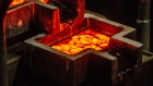 Liquid gold flows from a furnace into a casting mold to create a 28 kilogram gold bar in the foundry at the South Deep gold mine, operated by Gold Fields Ltd., in Westonaria, South Africa, on Thursday, March 9, 2017. South Deep is the world's largest gold deposit after Grasberg in Indonesia, makes up 60 percent of the company's reserves and the miner says it's capable of producing for 70 years. Photographer: Waldo Swiegers/Bloomberg