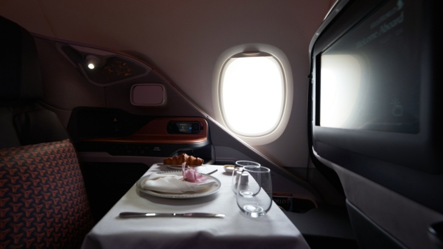 A breakfast table is prepared for a business class seat of a Singapore Airlines Ltd. Airbus SE A380