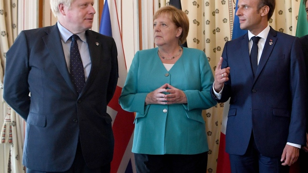 BIARRITZ, FRANCE - AUGUST 24: (L-R) British Prime Minister Boris Johnson, German Chancellor Angela Merkel and French President Emmanuel Macron pose during a G7 coordination meeting with the Group of Seven European members at the Hotel du Palais on August 24, 2019 in Biarritz, France. The French southwestern seaside resort of Biarritz is hosting the 45th G7 summit from August 24 to 26. High on the agenda will be the climate emergency, the US-China trade war, Britain's departure from the EU, and emergency talks on the Amazon wildfire crisis. (Photo by Andrew Parsons - Pool/Getty Images)