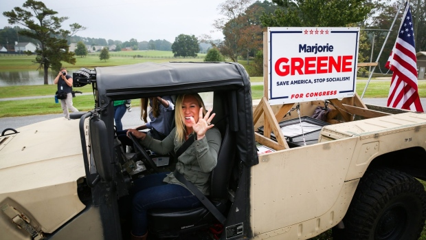 DALLAS, GA - OCTOBER 15: Georgia Republican House candidate Marjorie Taylor Greene and Sen. Kelly Loeffler (R-GA) leave a press conference in a Humvee during which Greene endorsed Loeffler on October 15, 2020 in Dallas, Georgia. Greene has been the subject of some controversy recently due to her support for the right-wing conspiracy group QAnon. (Photo by Dustin Chambers/Getty Images)