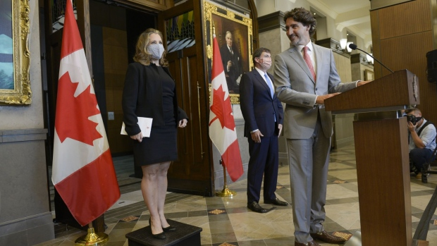 Justin Trudeau, Canada's prime minister, looks towards Chrystia Freeland, Canada's deputy prime minister and minister of finance, left, during a news conference in Ottawa, Ontario, Canada, on Tuesday, Aug. 18, 2020. Freeland, considered a pragmatic minister who handled the renegotiation of the North American free trade agreement with Mexico and the U.S., is the first woman to hold the finance minister role.
