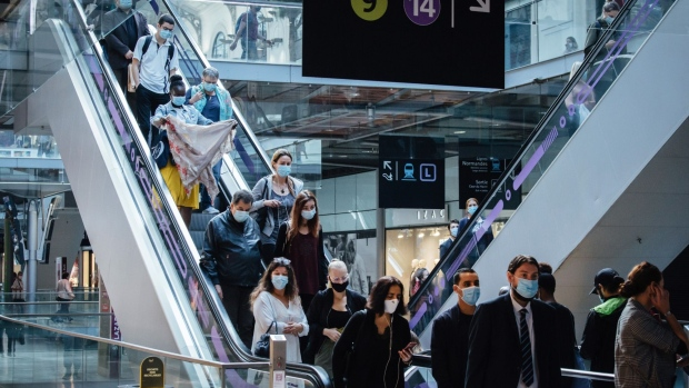 Morning rush hour commuters wear protective face masks while riding escalators at Gare Saint-Lazare railway station in Paris, France, on Wednesday, Sept. 9, 2020. France reported more than 6,000 new coronavirus infections on Tuesday as the pace of laboratory-confirmed cases picked up again after a post-weekend lull. Photographer: Cyril Marcilhacy/Bloomberg