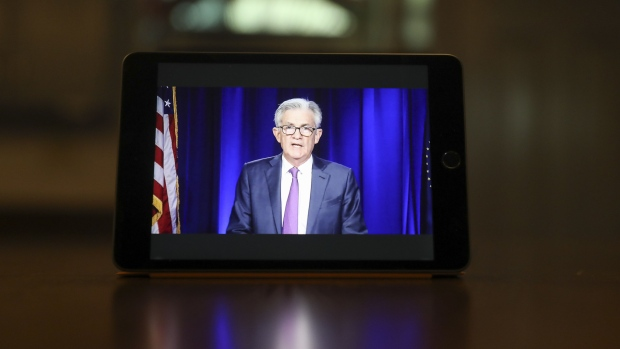 Jerome Powell, chairman of the U.S. Federal Reserve, speaks during a virtual news conference seen on a laptop computer in Tiskilwa, Illinois, U.S., on Wednesday, Sept. 16, 2020. The Federal Reserve left interest rates near zero and signaled it would hold them there through at least 2023 to help the U.S. economy recover from the coronavirus pandemic. Photographer: Daniel Acker/Bloomberg