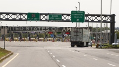 A truck approaches the Canada-U.S. border in Saint-Bernard-de-Lacolle, Quebec, Canada, on Wednesday, Sept. 16, 2020. The U.S. and Canada will extend restrictions on travel across the border until at least Oct. 21, CBC News reported, citing a person with direct knowledge of the situation. Photographer: Christinne Muschi/Bloomberg