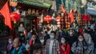 Visitors walk in Qianmen area in Beijing, China on Sunday, Oct. 4, 2020. A significant rebound in domestic travel over the Golden Week holiday is fueling optimism that consumers are starting to spend again after the pandemic-induced slump.