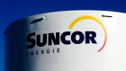 Suncor Energy Inc. signage is displayed on a petroleum storage tank in Montreal, Quebec, Canada, on Sunday, Nov. 6, 2011. Suncor Energy completed maintenance at its Terra Nova Floating Production, Storage and Offloading site off the coast of Newfoundland and Labrador, the company said in a statement on its website. Photographer: Bloomberg/Bloomberg