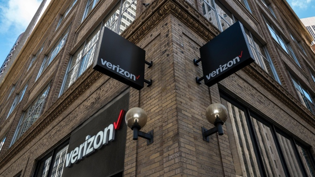 Signage is displayed outside a Verizon Communications Inc. store in San Francisco.