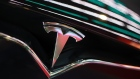 The Tesla Inc. logo is seen on the grille of a Model X electric vehicle at the Moscow Tesla Club in Moscow, Russia, on Friday, July 20, 2018. Tesla may nearly double the number of cars it�s selling in Russia after a mobile-phone retailer backed by billionaire Alisher Usmanov unexpectedly added electric vehicles to the line of gadgets it offers. MegaFon PJSC, said it received orders for 236 vehicles in June, the first month it started sales jointly with importer Moscow Tesla Club. Photographer: Andrey Rudakov/Bloomberg