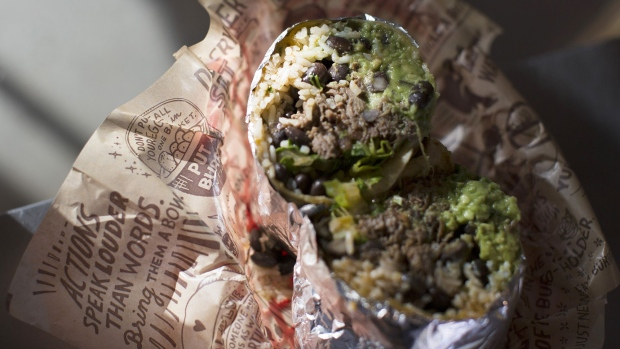 A burrito is arranged for a photograph at a Chipotle Mexican Grill Inc. restaurant in Tempe, Arizona, U.S., on Saturday, Oct. 21, 2017. Chipotle Mexican Grill Inc. is scheduled to release earnings figures on October 24.