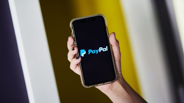 PayPal Holdings Inc. signage is displayed on an Apple Inc. iPhone in an arranged photograph taken in Little Falls, New Jersey, U.S., on Saturday, July 20, 2019. Paypal Holdings Inc. is scheduled to release earnings figures on July 24. Photographer: Gabby Jones/Bloomberg