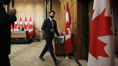 Justin Trudeau leaves an Ottawa news conference on Oct. 9.