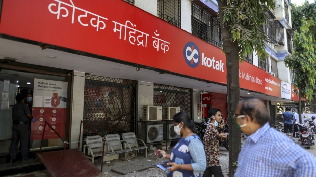 Customers wearing protective masks approach a Kotak Mahindra Bank Ltd. branch on a near-empty street in Mumbai, India, on Monday, May 4, 2020. India's central bank Governor Shaktikanta Das and the chief executive officers of the nation's banks have discussed ways to ensure credit flow to businesses once the world's toughest stay-at-home order ends.