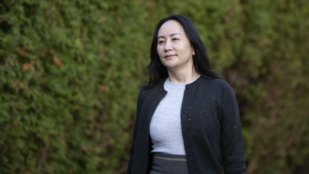 Meng Wanzhou, chief financial officer of Huawei Technologies Co., leaves her home to attend Supreme Court for a hearing in Vancouver, British Columbia, Canada, on Monday, Oct. 26, 2020. Canadian border and police officials involved in the 2018 arrest of Meng will testify this week in her long-running legal fight to avoid extradition to the U.S.