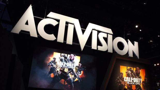 Attendees stand next to signage for Activision Blizzard Inc. Call Of Duty: Black Ops 4 video game during the E3 Electronic Entertainment Expo in Los Angeles. Photographer: Troy Harvey/Bloomberg