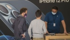 Customers wearing protective masks browse items at an Apple Inc. store in San Francisco, California, U.S., on Friday, Oct. 23, 2020. The iPhone 12 and iPhone 12 Pro went on sale in stores, but with individual shopping sessions replacing the famous lines and crowds around locations.