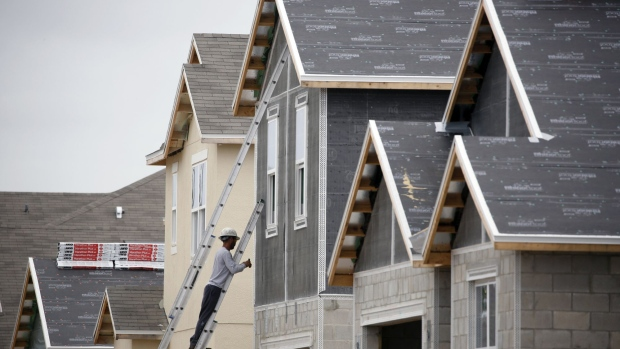 A contractor works on a house under construction at a KB Home development in Gibsonton, Florida, U.S., on Thursday, May 24, 2018. Home prices in 20 U.S. cities climbed more than forecast in March, driven by rising demand and a lack of inventory, according to S&P CoreLogic Case-Shiller data released Tuesday. Photographer: Luke Sharrett/Bloomberg