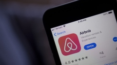 The Airbnb Inc. application is displayed in the App Store on an Apple Inc. iPhone in an arranged photograph taken in Arlington, Virginia, U.S., on Friday, March 8, 2019. Airbnb agreed to buy HotelTonight, its biggest acquisition yet, in a move to increase hotel listings on the site ahead of an eventual initial public offering for the home-sharing startup. Photographer: Andrew Harrer/Bloomberg