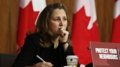 "Chrystia Freeland, Canada's deputy prime minister and minister of finance, listens during a news conference in Ottawa, Ontario, Canada, on Tuesday, Oct. 20, 2020. Prime Minister Justin Trudeau warned opposition lawmakers they will trigger an election in Canada if they approve the creation of an ""anti-corruption"" committee."