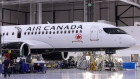 An Airbus SE A220 plane with Air Canada Livery sits at the end of the assembly line at the Airbus Canada LP assembly and finishing site in Mirabel, Quebec, Canada, on Thursday, Feb. 20, 2020. Airbus CEO Guillaume Faury said that the company plans to invest up to 1 billion euros on the A220 this year.