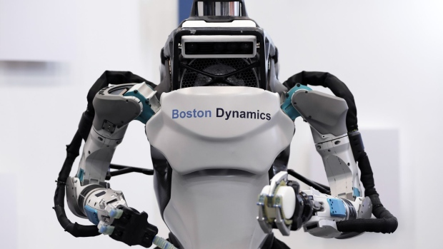 A Boston Dynamics Inc. Atlas humanoid robot is displayed at the SoftBank Robot World 2017 in Tokyo, Japan, on Tuesday, Nov. 21, 2017. SoftBank Chief Executive Officer Masayoshi Son has put money into robots, artificial intelligence, microchips and satellites, sketching a vision of the future where a trillion devices are connected to the internet and technology is integrated into humans. Photographer: Kiyoshi Ota/Bloomberg