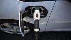 A ClipperCreek Inc. charging plug is seen connected to a General Motors Co. (GM) Chevrolet Volt electric vehicle (EV) at a charging station in Los Angeles, California, U.S., on Tuesday, July 11, 2017. City Council committee signed off financing for a program to provide more than $1.1 million in funding to add dozens of EV charging stations around the city in addition to the 560 already in place at city facilities and street locations. Photographer: Dania Maxwell/Bloomberg