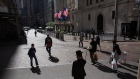 Pedestrians pass in front of the New York Stock Exchange (NYSE) in New York, U.S., on Friday, Oct. 2, 2020.